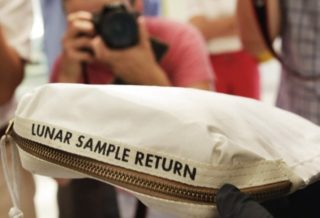 Neil Armstrong Moon Dust Bag Sold for $1.8m at Auction