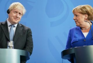 Merkel Warns Johnson: Brexit Deal has No Chance without Compromise on Ireland
